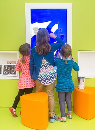 Children painting on a digital canvas