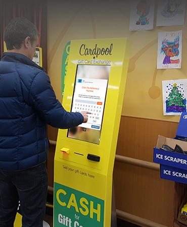 Man using Cardpool financial gift card kiosk