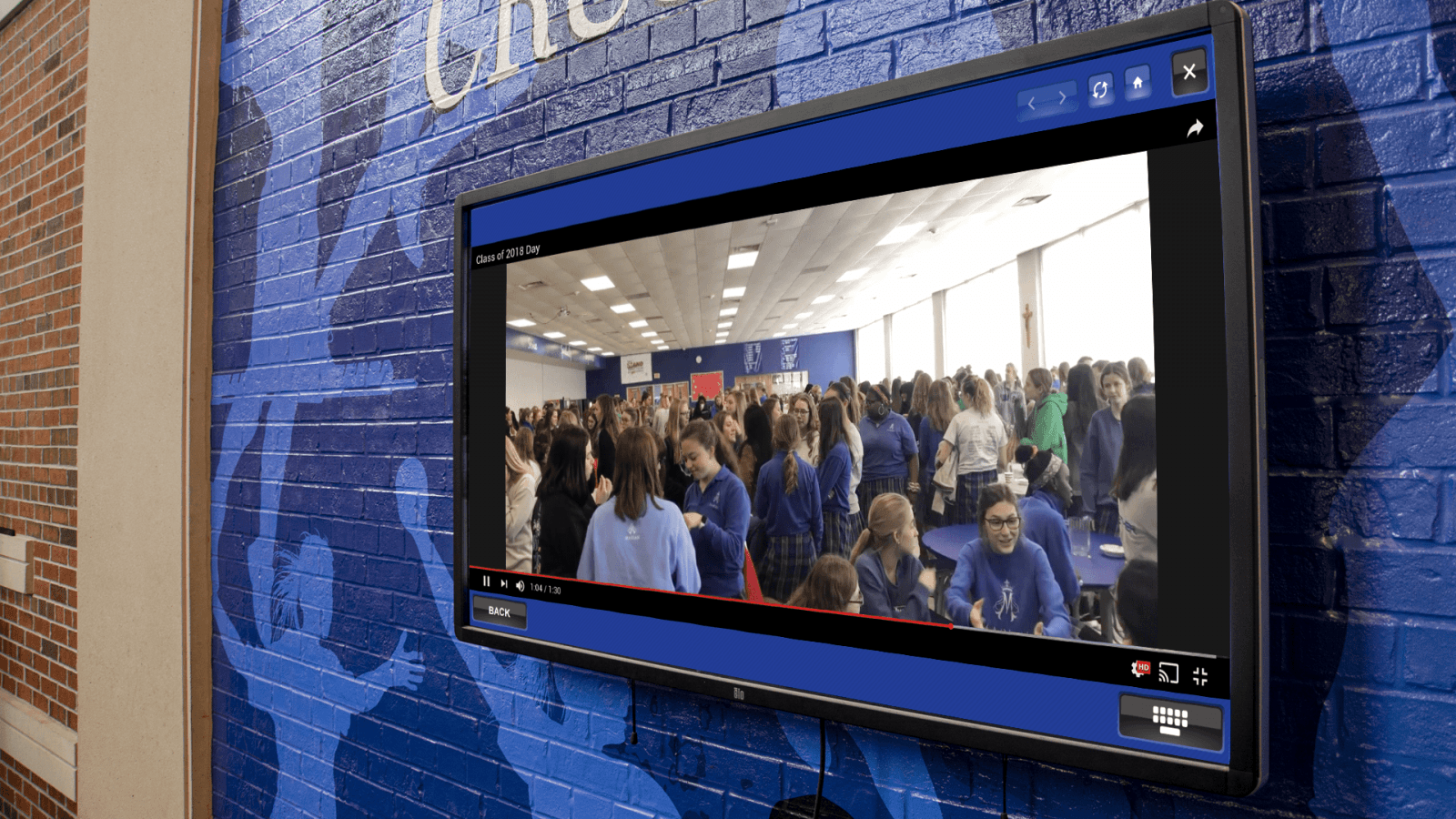 Marian High School's Digital Trophy Case allows visitors, students, and alumni to explore the school's activities through video and images.