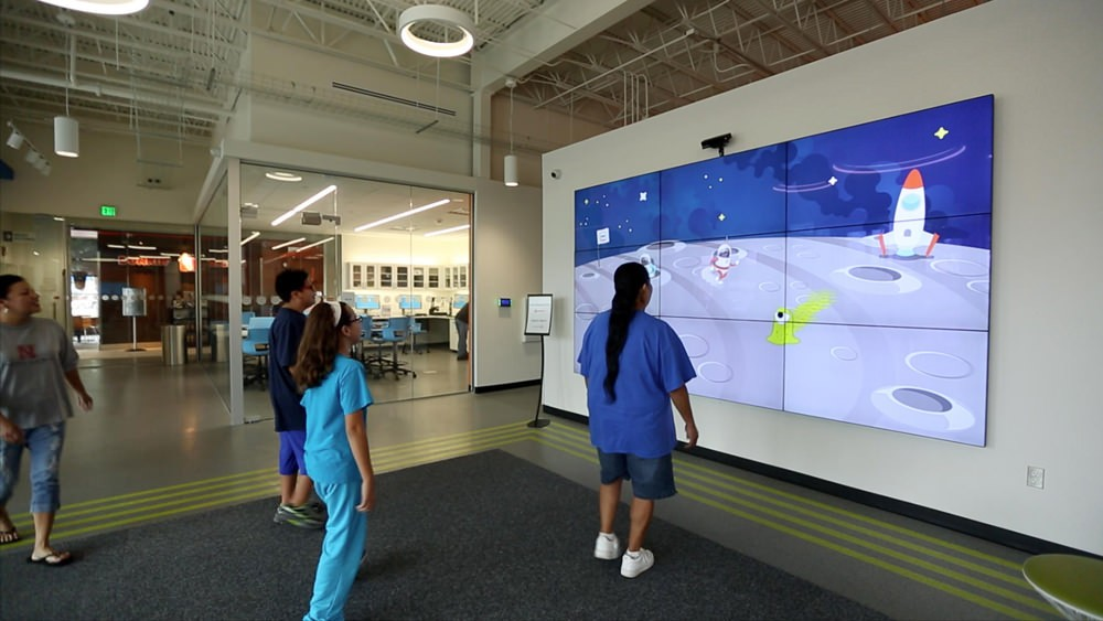 Do Space's welcome wall consists of 9 screens to engage and attract guests.