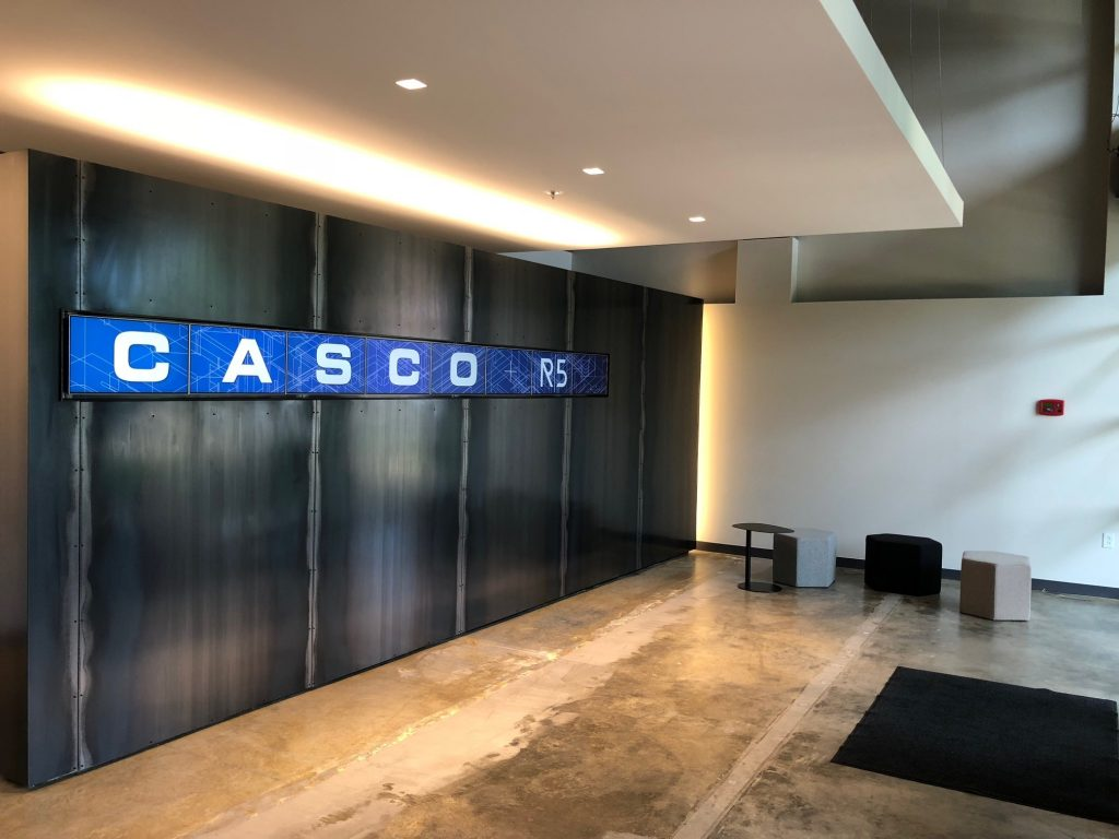 Casco + R5's digital signage wall consists of several screens to display visuals.