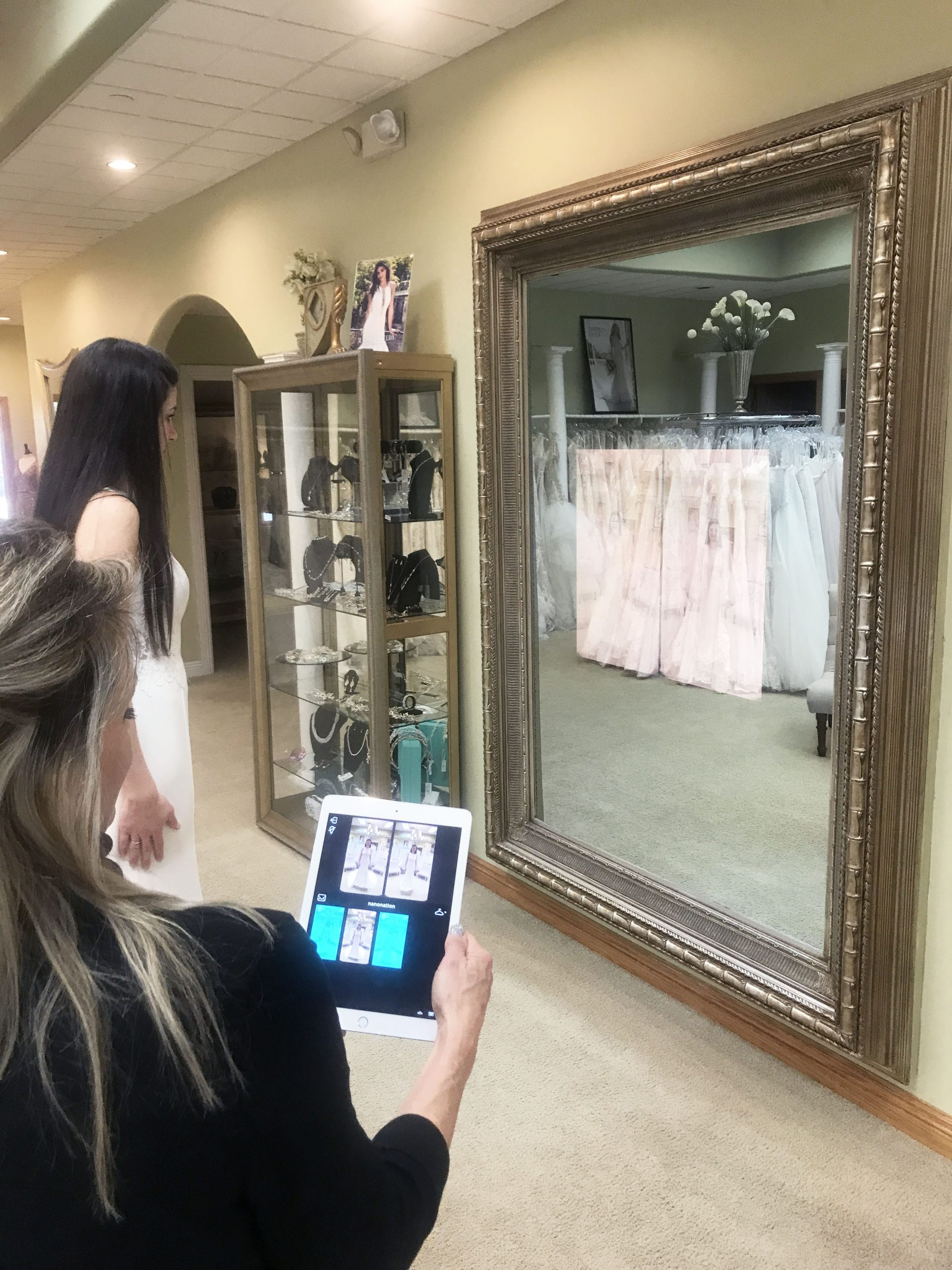 Bride comparing gowns with the Magic Mirror