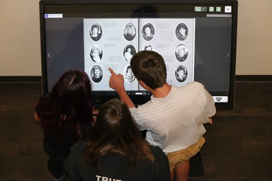 Meridian High School's Digital Trophy Case Kiosk is used to display digital yearbooks for users to flip through.