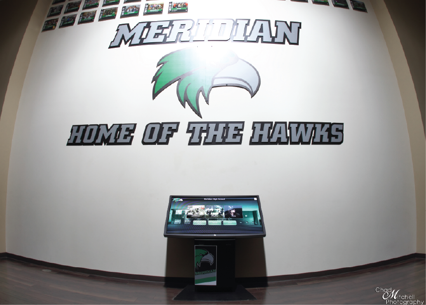 Meridian High School's Digital Trophy Case Kiosk is used to display yearbooks, sports records, and more.