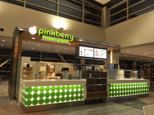 Two digital menu boards at a Pinkberry kiosk.