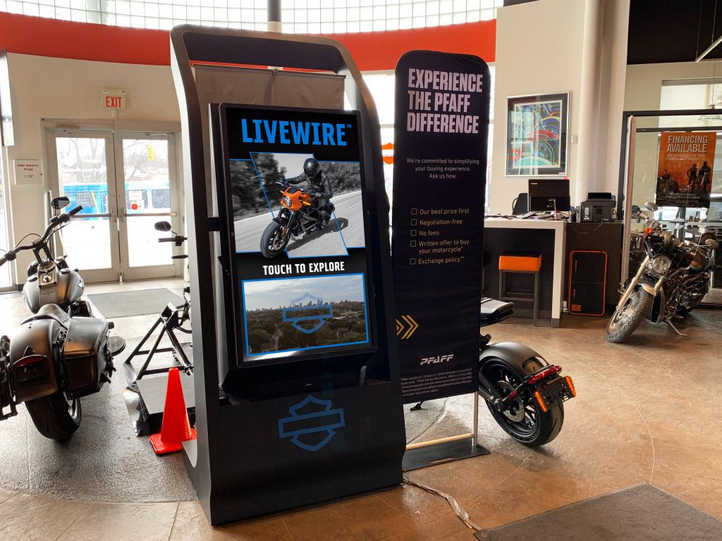 A Harley-Davidson Branded kiosk shows the Livewire interface.