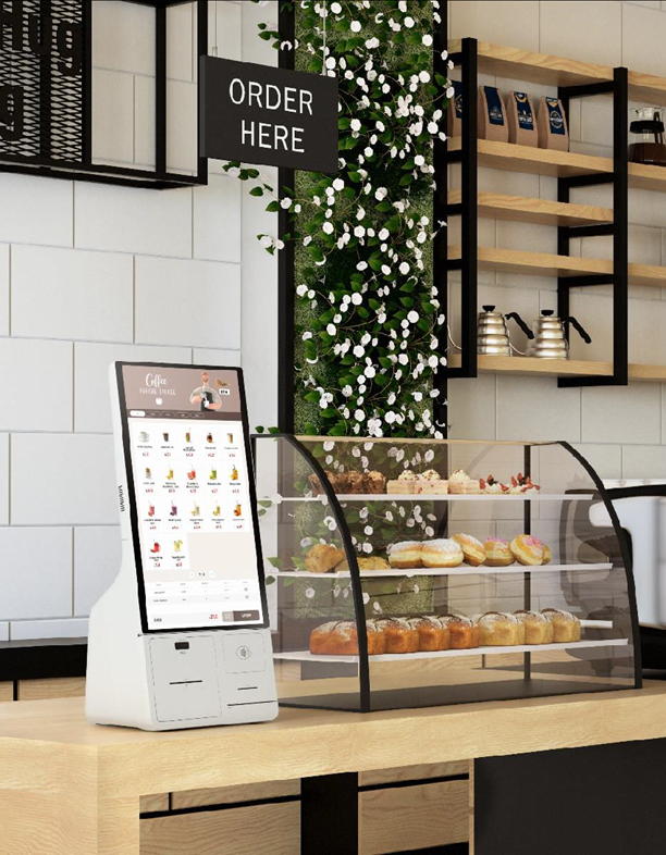 Samsung Kiosk sitting on countertop in cafe.